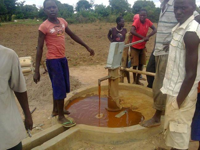 Orange, iron rich water is a good sign of a rusting pump (photo: WaterAid Uganda)